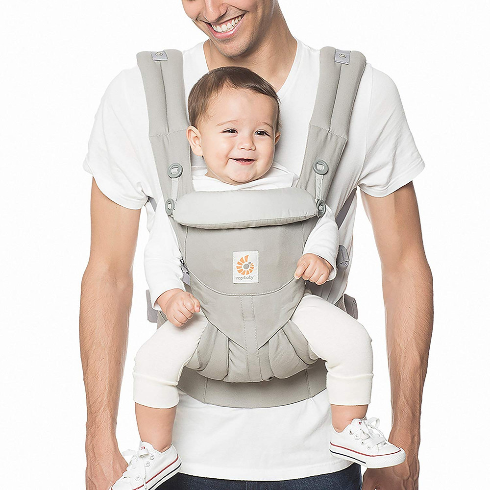 Dad and baby smiling while dad is carrying baby in ergo 360 baby carrier on front