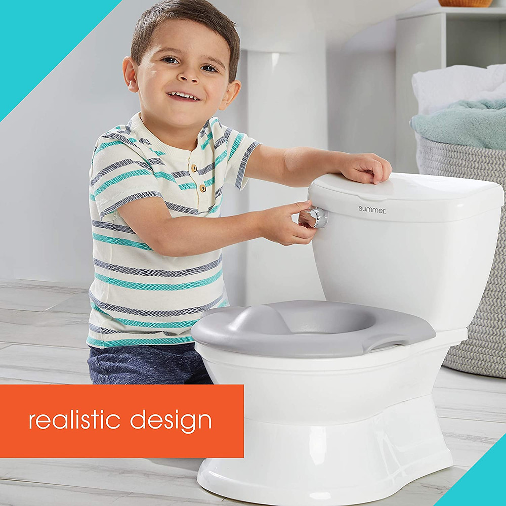 Little boy flushing his training potty and smiling