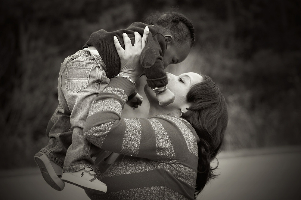 Mother holding baby close to face