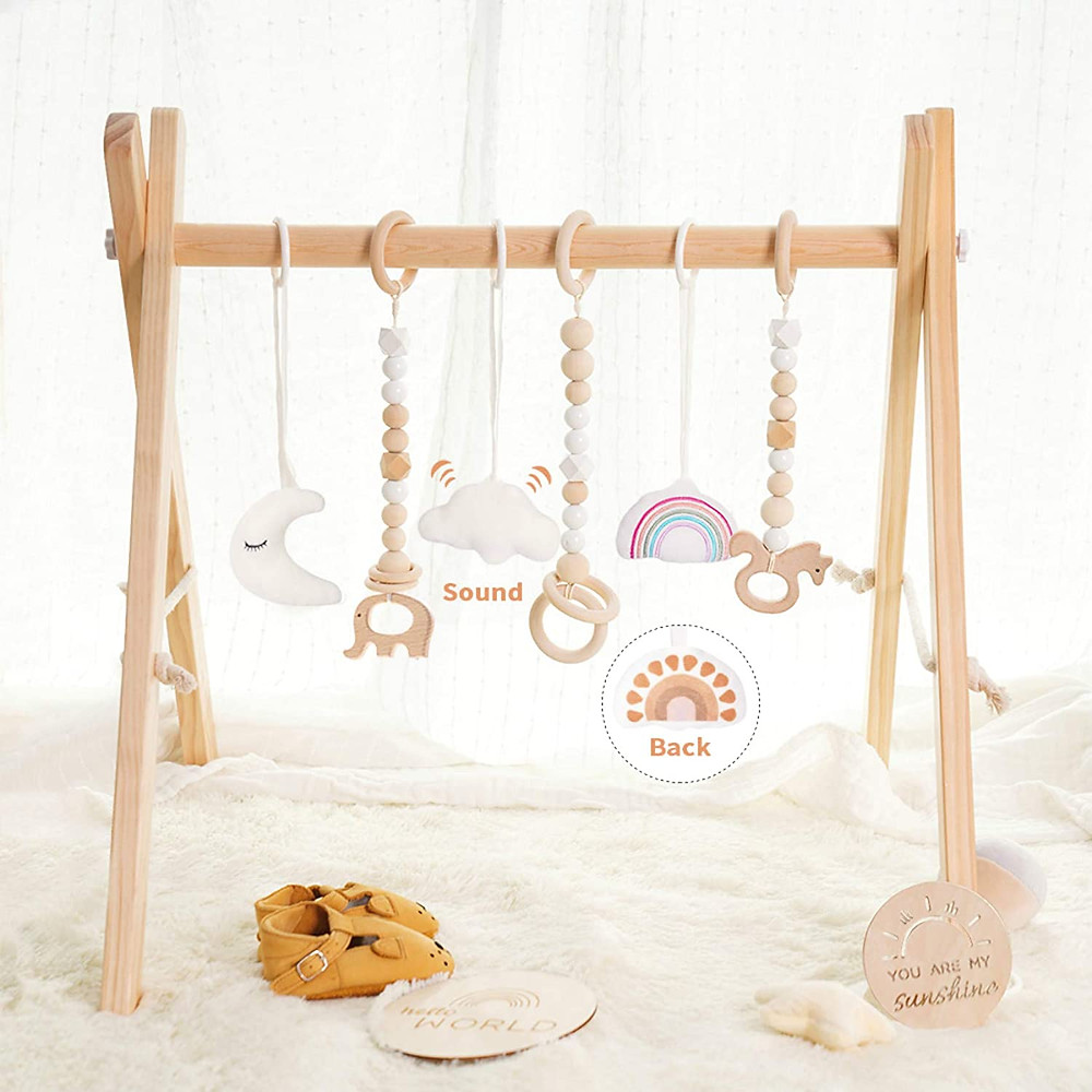 product photo of wooden baby gym with rainbow and animal rings