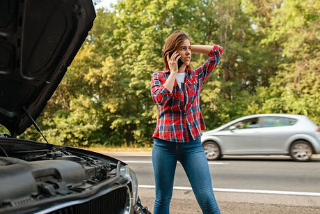 woman-calling-a-tow-truck-on-road-car-br