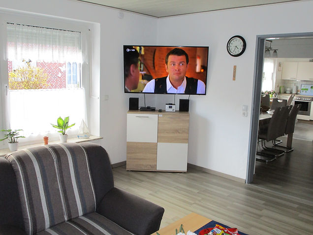 Wohnzimmer,Fernseher, Fenster, Ferienhau