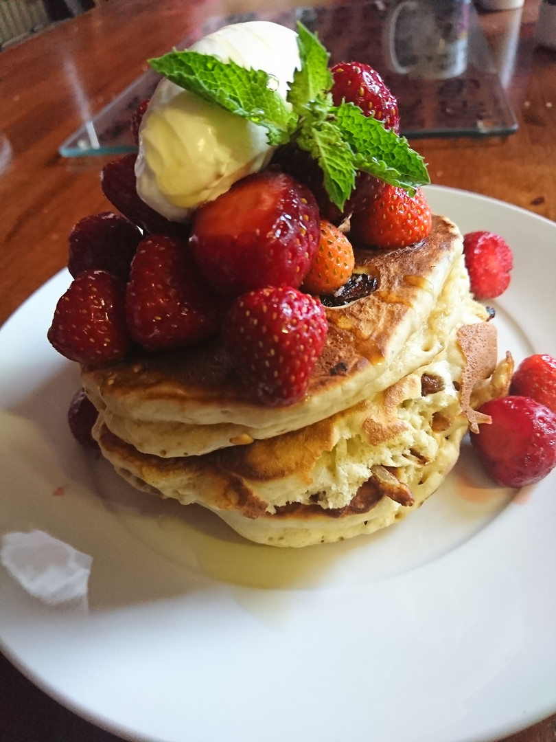 Fresh pancakes, local strawberries