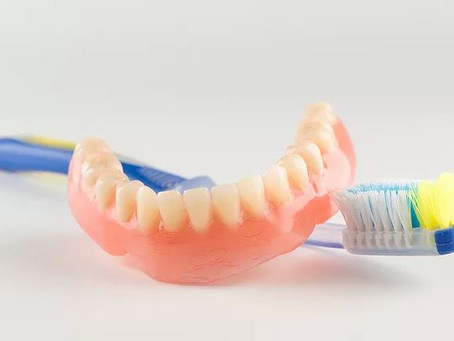 Why should you see the dentist if you have dentures?