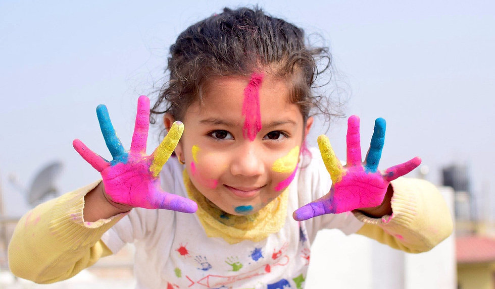 Girl with colorfull hands