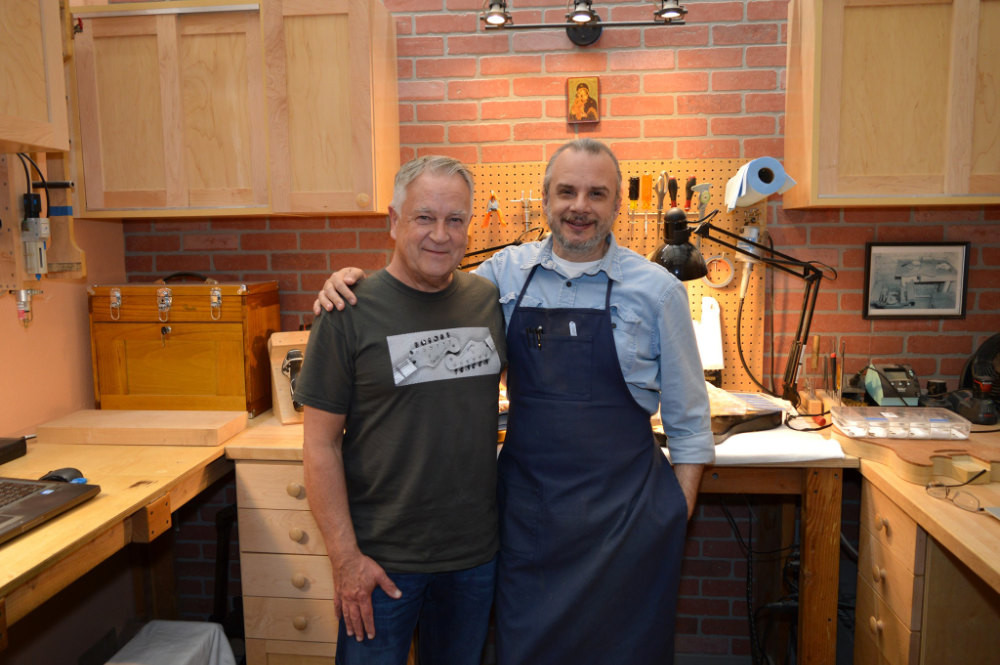 Author Gary Davies and Principal Master Builder Yuriy Shishkov in Yuriy's cubicle at the Fender Custom Shop in Corona California in 2020