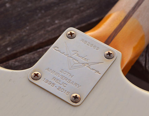 The neck plate of a 2015 20th Anniversary Custom Shop relic