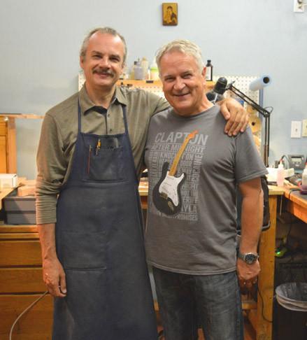 Senior master builder Yuriy Shishkov Fender Custom Shop and Gary Davies author of Anniversary Stratocaster Stories pictured in Yuriy's work area before the Custom Shop makeover