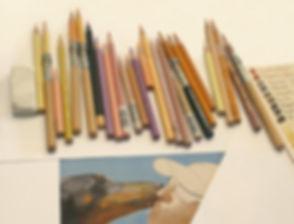 colored pencils and a portrait in progress