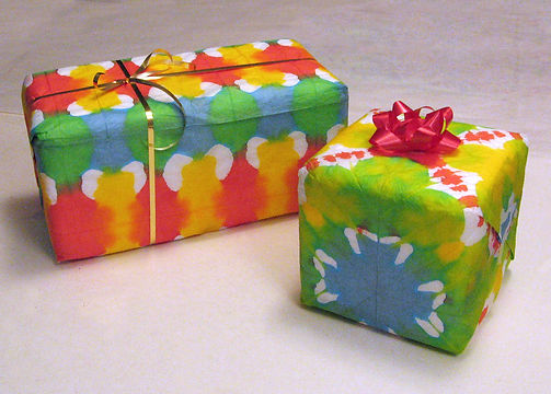 "Presents wrapped with handmade ""Pretty Paper"" by artist Kevin Roeckl"