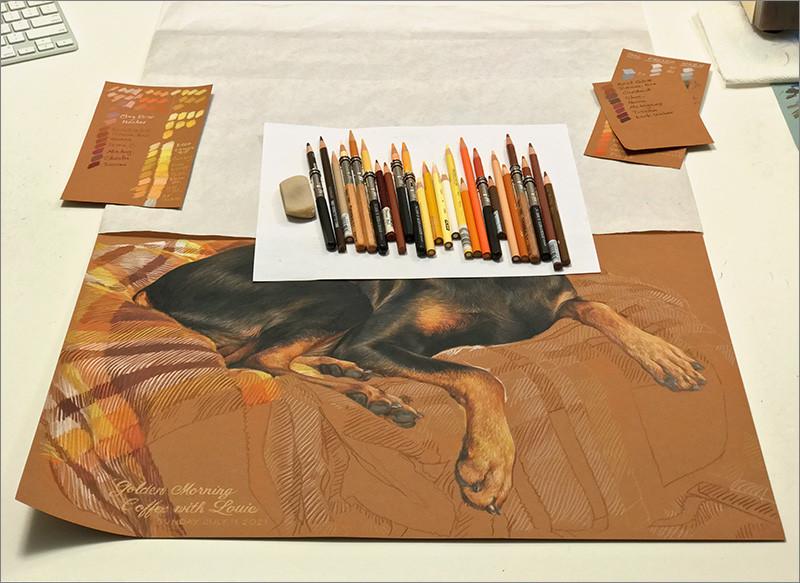 Colored pencil portrait of a black Doberman in progress in Kevin's art studio with colored pencils