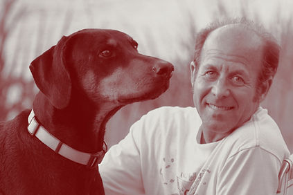 Photo of Kevin Roeckl with Doberman dog