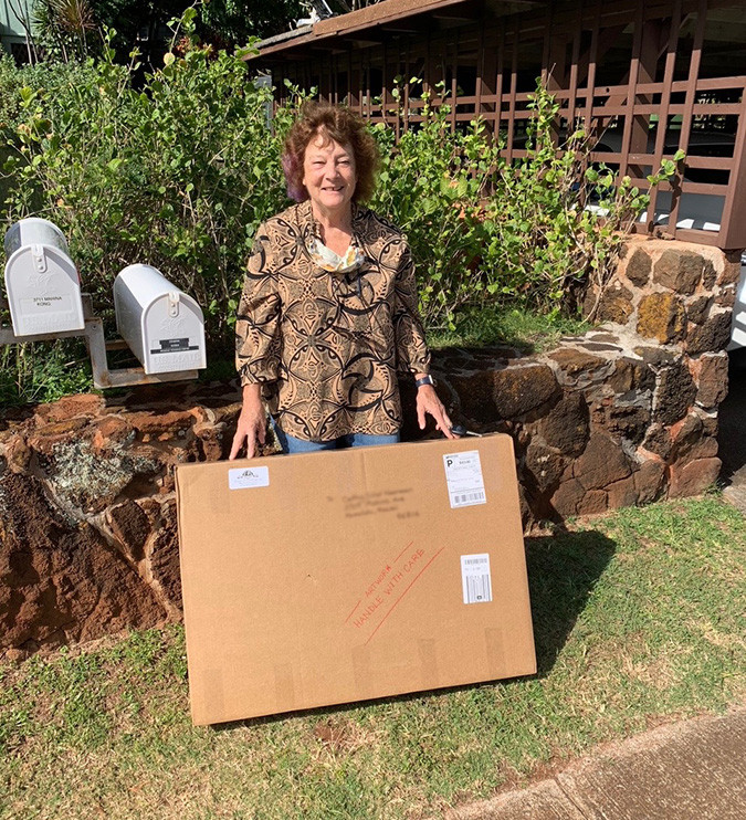 Portrait client receiving shipment of Roeckl portrait