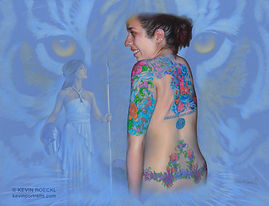 Fine Art portrait of a woman with tattoos, the goddess Athena, and tiger eyes