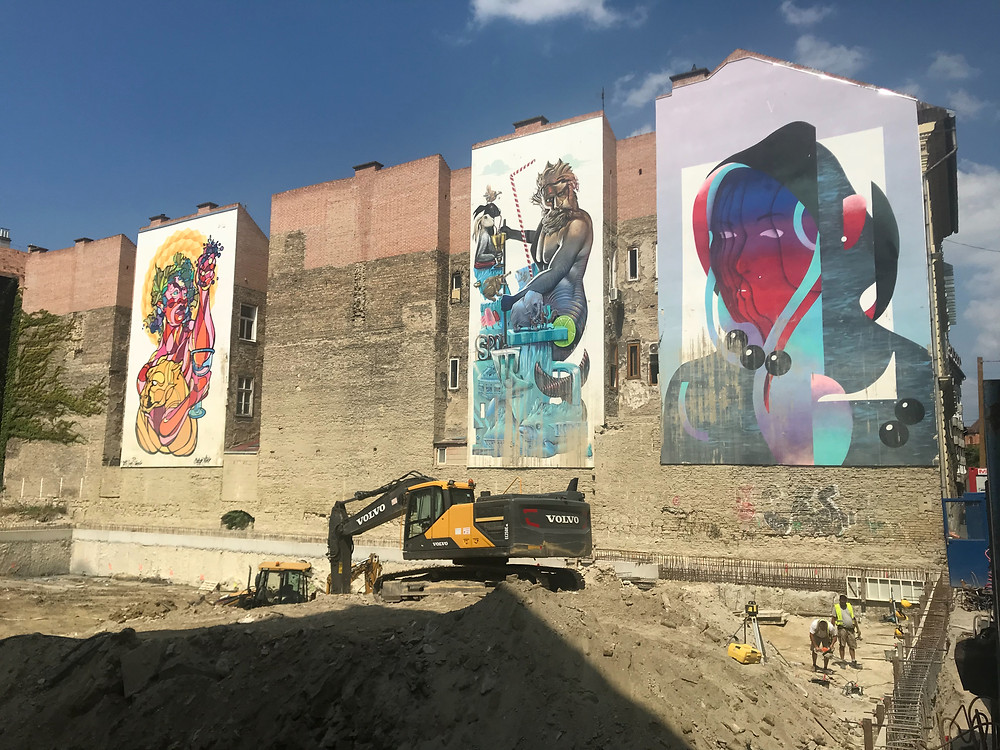 Those three magnificent Mural Paintings will probably disappear as new houses take place. Read our Street Art Guide to Big Murals in Budapest on Sticks & Spoons Food Travel.