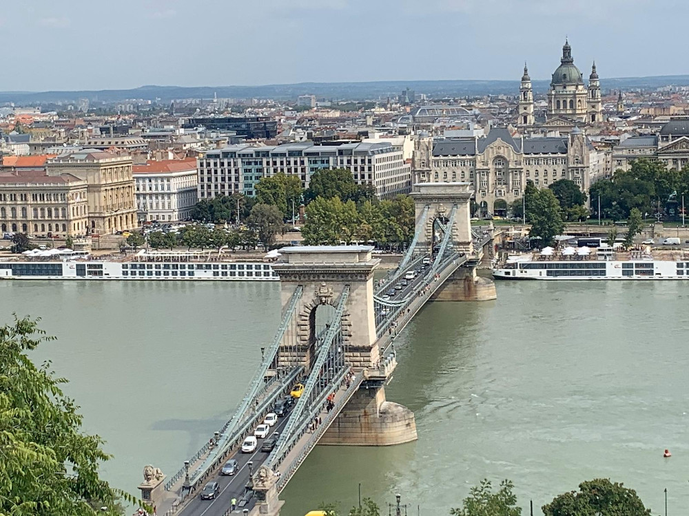 Budapest view over Chain Bridge from the Buda side. Budapest have a long history and fantastic sites to visit if you want to soak up history and culture. It's budget-friendly too so don't forget to entertain yourself while visiting the Capital of Hungare. Find helpful travel tips in this Budapest Guide.
