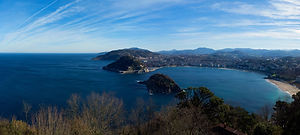 San Sebastian with the bay of La Perla. San Sebastian is a Foodie Spot and the home of Pintxos.