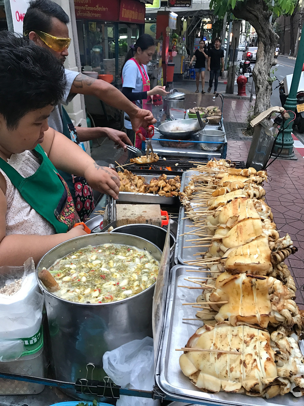 Two professional Street Food Vendors in Bangkok, grilling Octopus and Squids in a personal, unique way.