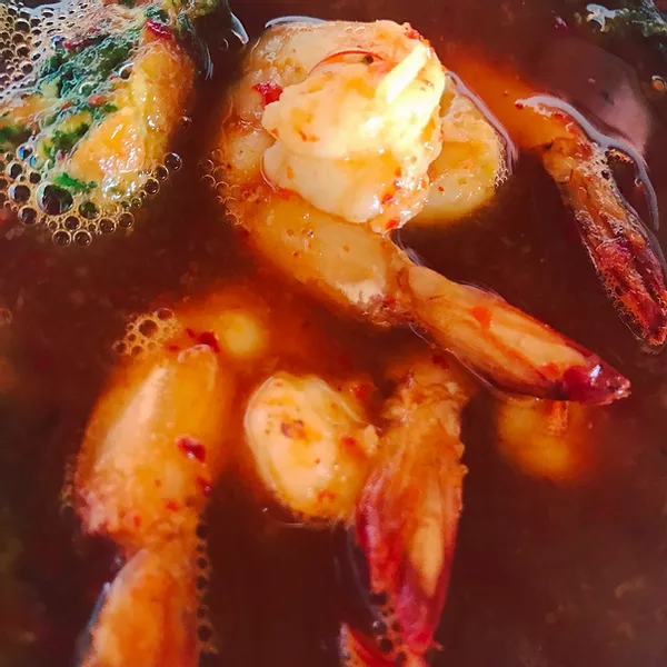 Spicy prawn soup. Broth, infused with red curry, lemongrass and chili. One of many Street Food inspired dishes on Koh Mak Island you can find in our Street Food Guide at Food and Travel Guides.