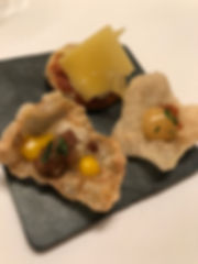Apptizers at Onyx. Delicious Amuse Bouche with traditional cheese and charcuterie on rice crackers.