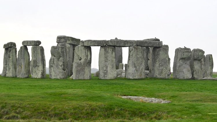 Stonehenge against a grey sky. England have so much to offer exploring historical monuments and museums, visiting pubs and restaurants. This is a combination of everything good and nice when visiting England!