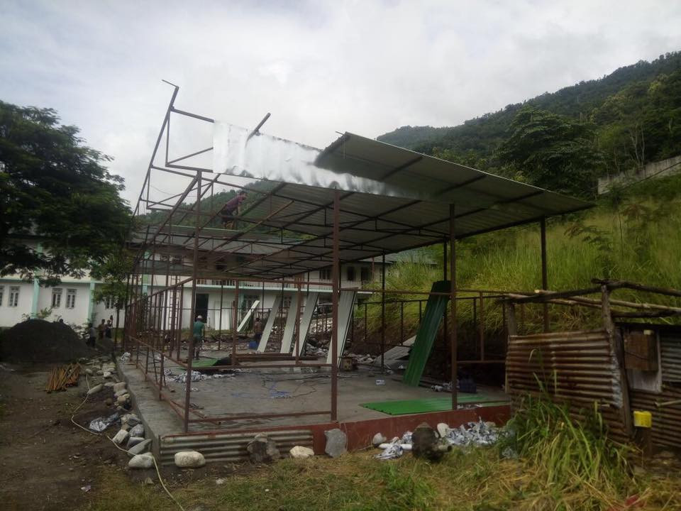 Shed being erected at JNV-Pipaley by Dans Energy to provide temporary relief to hostellers displaced by rising reservoir of the 96 MW Jorethang Loop hydel project