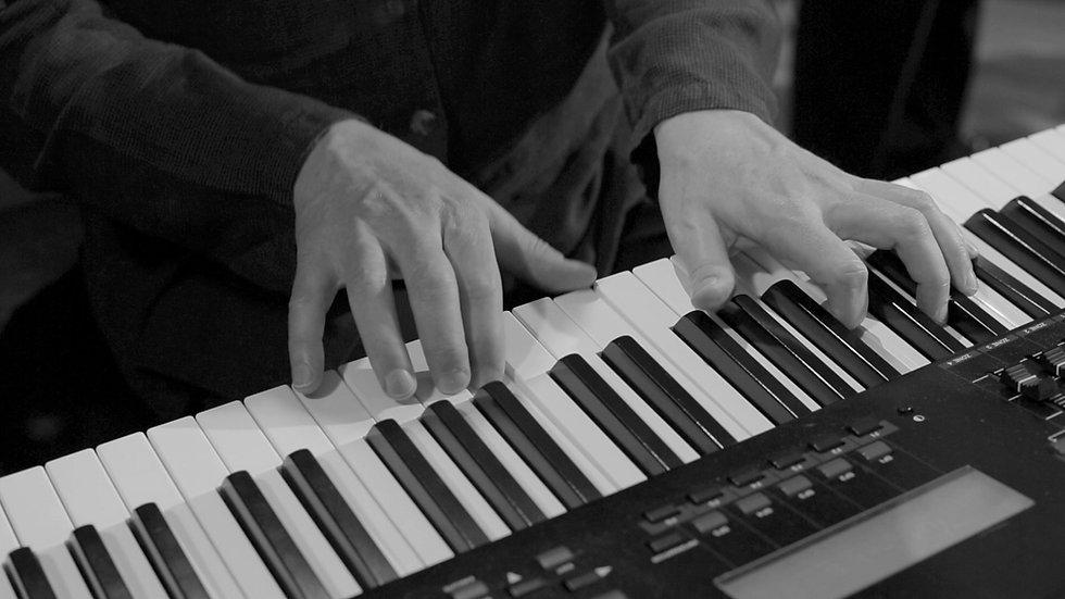 Uncl-Calv-piano-hands-04_edited.jpg