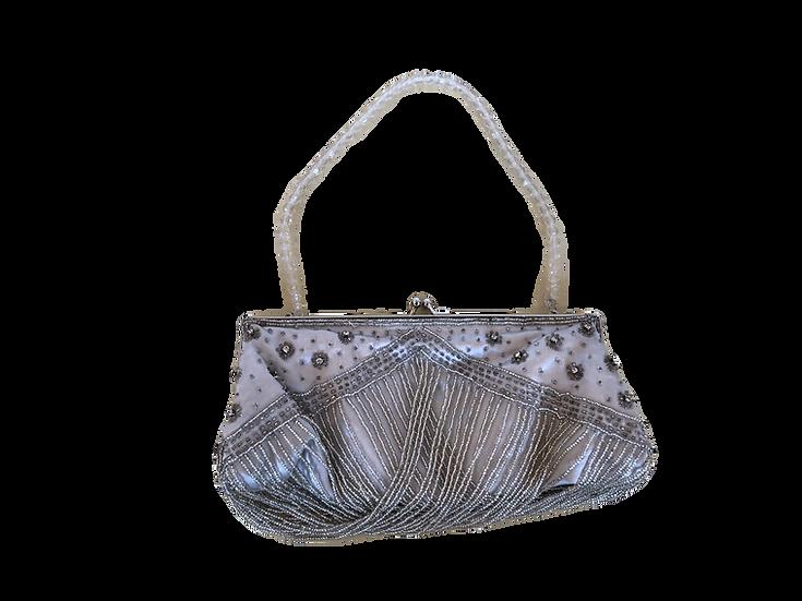 Partytasche mit Perlenstickerei und Fransen