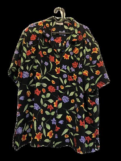 Schwarze Bluse mit bunten Blumen und Goldknöpfen