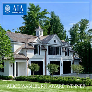 award winning carriage house with 3 garage bays and a guest apartment above outside lattice enclosed storage
