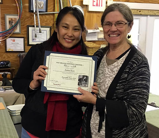 Singapore dog trainer, Anna Koo receiving certificate from Pat Miller