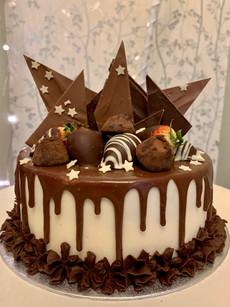 Celebration cake with hand-made chocolate shards, choc truffles and choc dipped strawberries