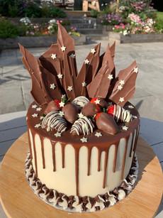 Chocolate cake with hand-made chocolate shards and choc dipped strawberries