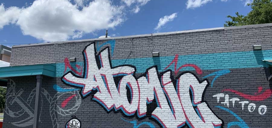 Big graffiti with lettering, drawing, and tagging by a street graffiti artist from Color Cartel