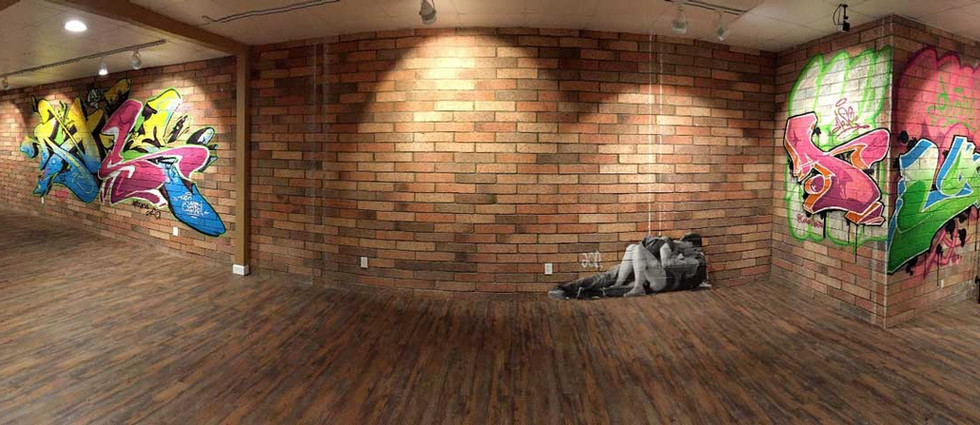 Inner brick wall with different graffiti from our famous spray paint artist