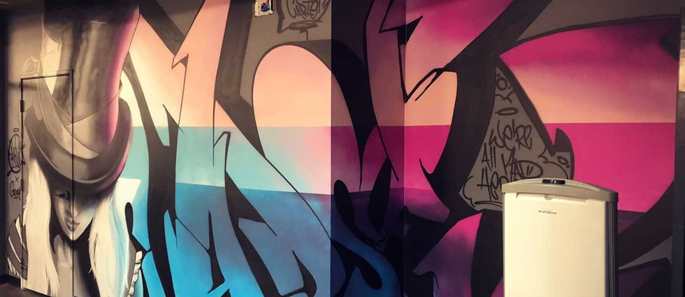 Wall painted by professional graffiti artists: portrait and lettering with gradient effect