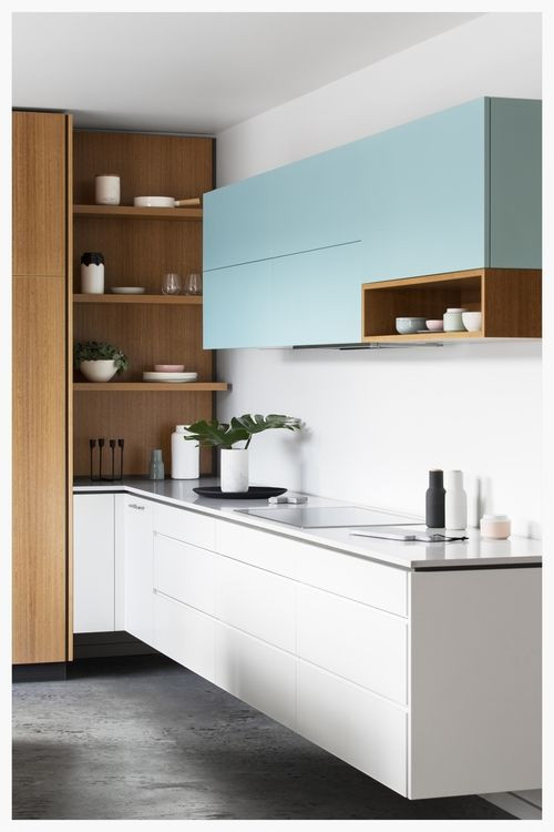 Extend your floor finish under the cabinets for an uninterrupted view from wall to wall