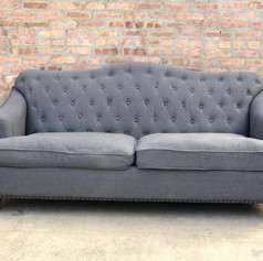 Gray tufted linen sofa
