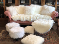 Flokati pillows, assorted rugs, ottomans