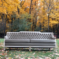 Pale sage tufted sofa