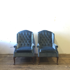 Navy tufted velvet wingback chairs