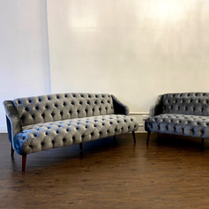 Gray velvet tufted sofas