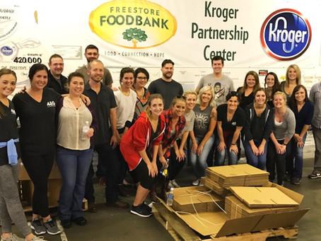 Power-Packed Teamwork: 4EG Staff Volunteers at Freestore Foodbank