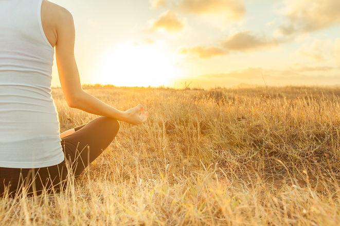 Yoga outdoor. Happy woman doing yoga exe