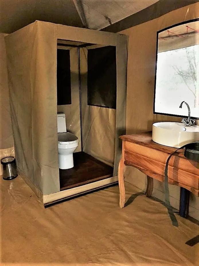 Into Wild Africa Camp Bathroom