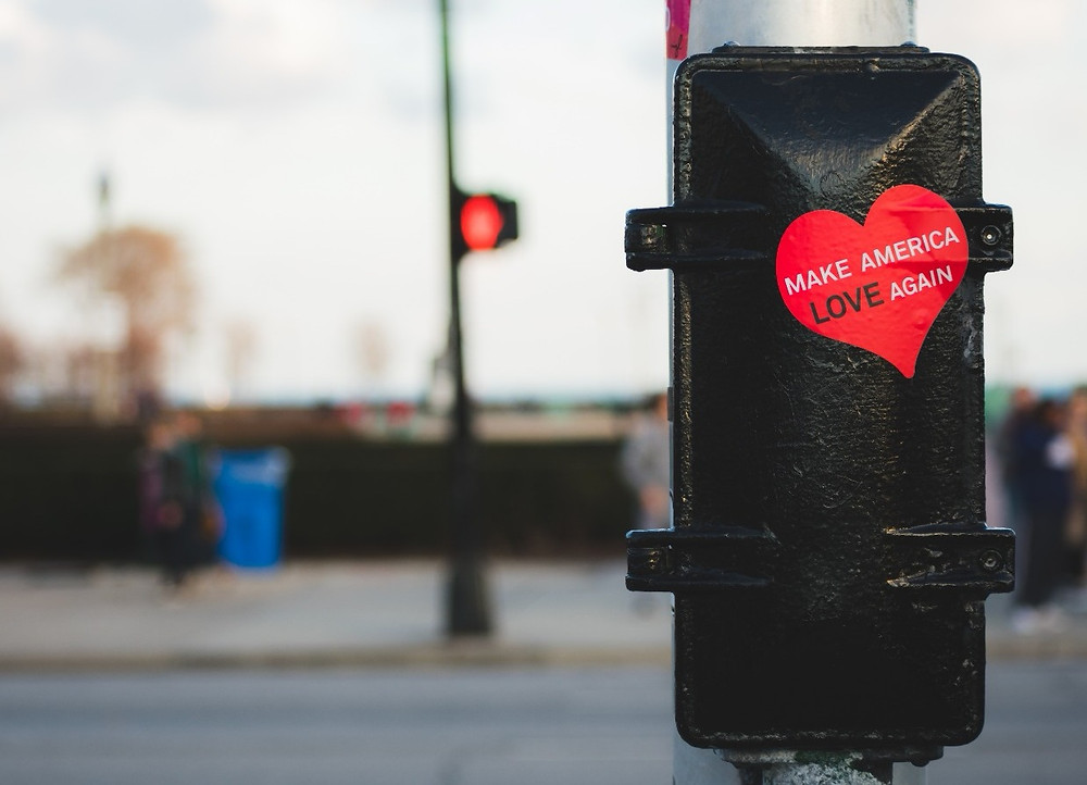 "Photo by Kayle Kaupanger on Unsplash of sticker that says ""Make America Love Again"""