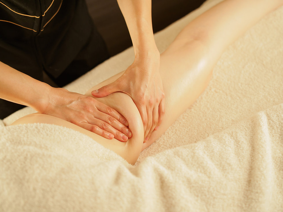 _Woman receiving a thigh massage.jpg