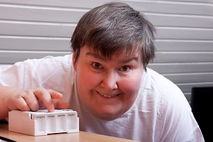 mentally disabled woman with some pills points to viewer.jpg