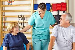 Happy physiotherapist giving senior grou