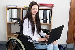 Confident happy businesswoman in wheelch
